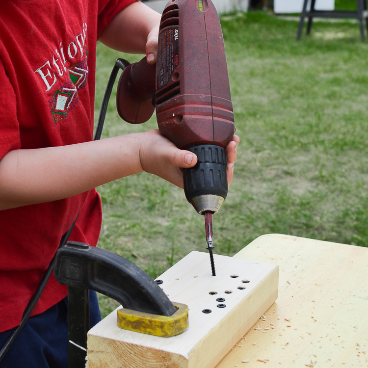Woodscrew Art: Working with a drill.
