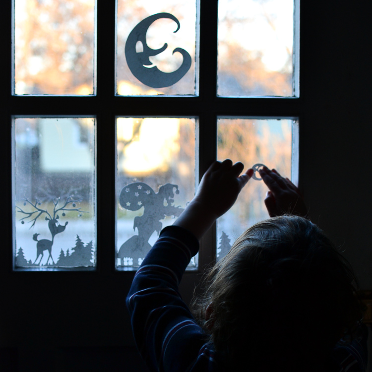 My kids are decorating the windows with paper silhouettes