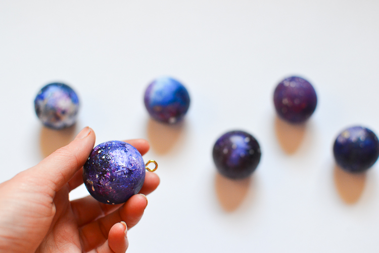DIY Kid-Made Space Christmas Ornaments: Adding eye hooks
