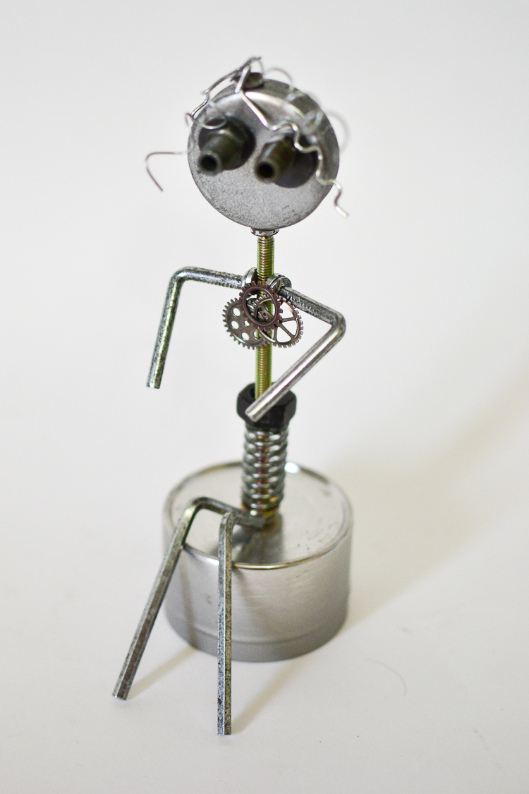 Magnetic scrap metal sculptures, robots and machines. A sad looking robot girl!