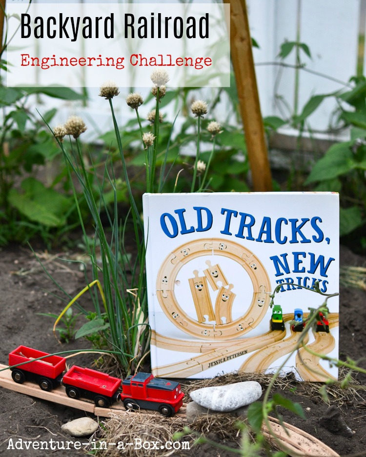 Kids engineering an outdoor railroad - how fun is that! A perfect summer STEM challenge for our backyard.