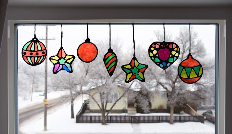 Christmas suncatchers on the windows