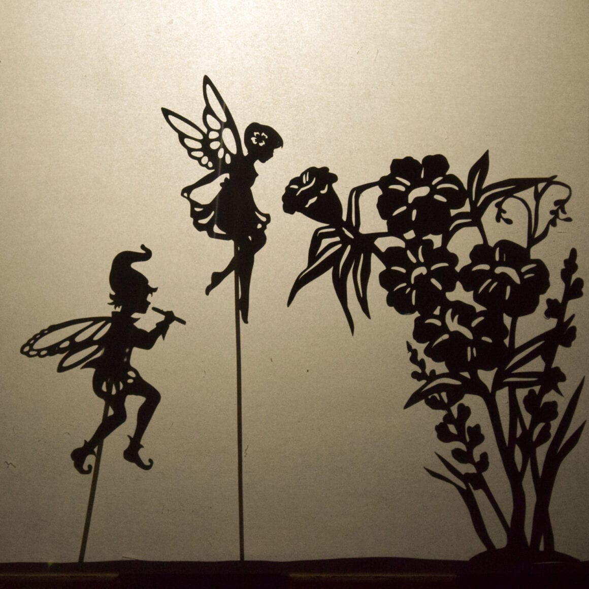 Fairy puppets with a shadow puppet theatre