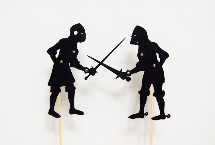 Two shadow puppets of knights