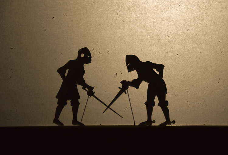 Shadow puppet play: two knights fighting
